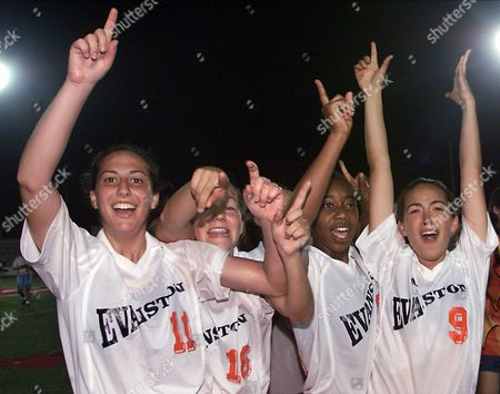 HUBBARTH Evanston's Sam Epstein (11), Kathleen Head (16), Akilah Moore and Cassidy Hubbarth (9) celebrate after Evanston defeated Wheaton Warrenville South 2-0 to win the IHSA Class AA girls championship soccer match at North Central College in Naperville, Ill