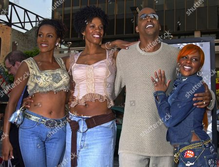 """KIM Miguel A. Nunez Jr., second from right, star of the movie """"Juwanna Mann,"""" is shown with, from left, Vivica A. Fox, Kim Wayans and Lil' Kim, right, at the world premiere of the film, at Grauman's Chinese Theatre in Los Angeles' Hollywood district. The film opens nationwide June 21"""