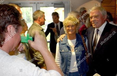 BURNETT FREDERICK HALL Steve Burnett, left, of Corbin, Ky., takes a photo of Peggy Frederick, of Williamsburg, Ky, with Country Music Star Tom T. Hall, right, during the grand opening of the Kentucky Music Hall of Fame & Museum, in Renfro Valley, Ky