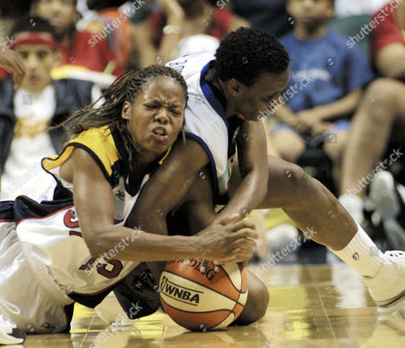 MCCRAY, ROBINSON Indiana Fever guard Nikki McCray, left, and New York Liberty forward Crystal Robinson fight for a loose ball during the second half in Indianapolis, . The Liberty defeated the Fever 70-62