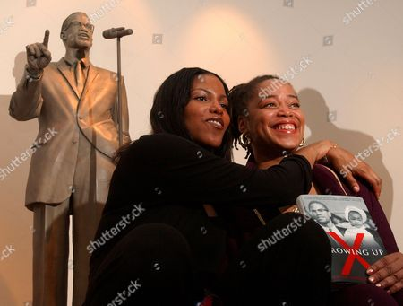 SHABAZZ A statue of Malcolm X stands behind two of his daughters Ilyasah, center, and Malaak Shabazz at a book signing at the Audubon Ballroom,, in New York. The Audubon Ballroom is where Malcolm X was shot. Horrible tragedies and lesser --though still public --troubles seem to have followed the daughters of Malcolm X from his 1965 assassination down to the present, with the family at odds over a trove of the black nationalist leader's writings that were nearly auctioned off