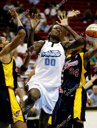 MACHANGUANA Orlando Miracle's Clarisse Machanguana (00) loses control of the ball after colliding with the Indiana Fever's Tamika Catchings (24), right, and Olympia Scott-Richardson, left, during the first half on at the TD Waterhouse Centre in Orlando, Fla