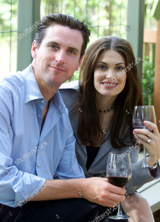 NEWSOM Gavin Newsom, left, and his wife, Kimberly Guilfoyle Newsom, right, pose for a picture at the PlumpJack winery in Oakville, Calif., . San Francisco Mayor Gavin Newsom and his wife, Court TV legal analyst Kimberly Guilfoyle Newsom, are filing for divorce after three years of marriage. In a joint statement issued Wednesday by the mayor's office, the Newsoms cited the strain posed by their high-profile, bicoastal careers as the reason for the split