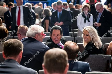 Wayne Newton, Kathleen McCrone Entertainer Wayne Newton, center, sits with his wife Kathleen McCrone, right, before the third presidential debate at University of Nevada in Las Vegas