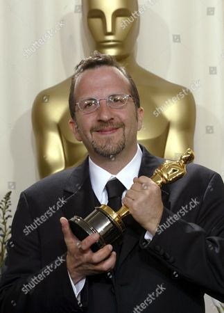 "WARNER Aron Warner poses with his Oscar trophy for best animated feature film for ""Shrek"" during the 74th annual Academy Awards on in Los Angeles"