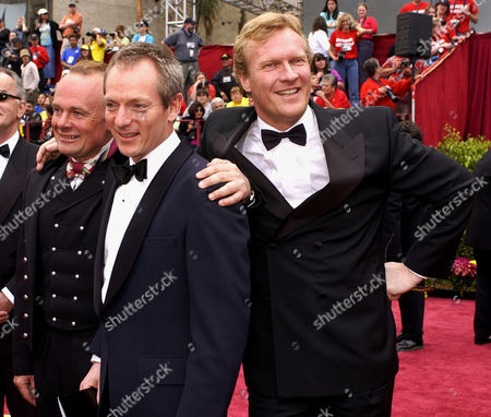 """ELLEFSEN NORDIN NAESS Actors Per Christian Ellefsen, left, Sven Nordin, right, and director Peter Naess, of the Norwegian film """"Elling"""" arrive for the 74th Academy Awards, in Los Angeles. The film is nominated for best foreign language film of the year"""