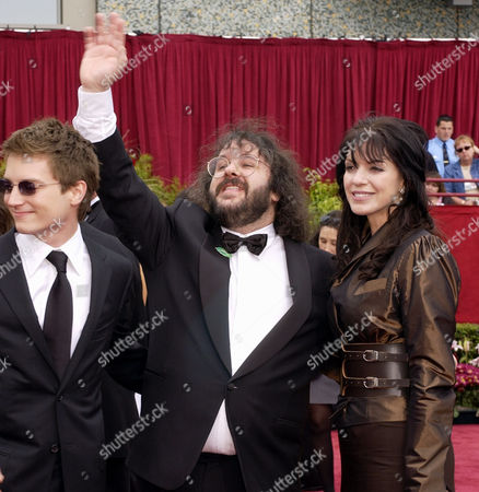 """JACKSON WOOD WALSH Producer Peter Jackson, of New Zealand, center, and his wife, Fran Walsh, arrive with actor Elijah Wood to the 74th annual Academy Awards, in Los Angeles. Jackons's film """"The Lord of the Rings: The Fellowship of the Ring,"""" is nominated for best picture of the year. Wood starred in the film"""