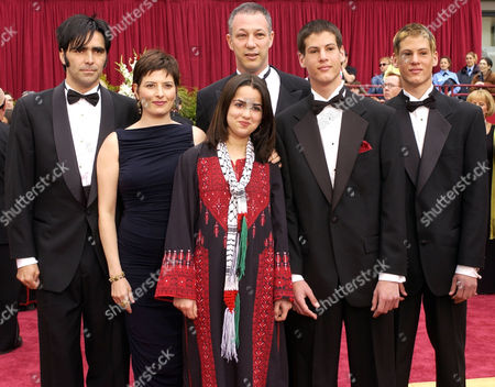 "DANIEL Carlos Bolado, left, Justine Shapiro, Sanabel, front center, B.Z. Goldberg, and twins Yarko and Daniel from the documentary feature ""Promises,"" arrive for the 74th annual Academy Awards, in Los Angeles"