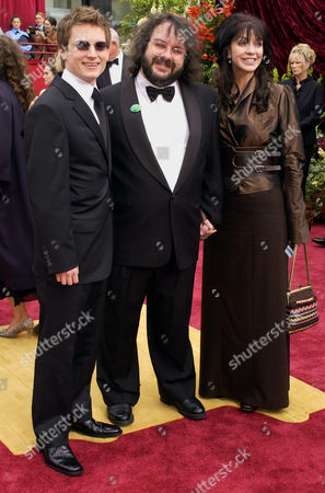 """JACKSON WALSH WOOD Producer Peter Jackson, of New Zealand, center, and his wife, Fran Walsh, arrive with actor Elijah Wood during the 74th annual Academy Awards, in Los Angeles. Jackons's film """"The Lord of the Rings: The Fellowship of the Ring"""" is nominated for best picture of the year. Wood starred in the film"""