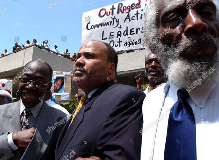 GREGORY Activists Martin Luther King III, center, and Dick Gregory, right, walk the streets in a demonstration calling for the firing of Inglewood police officer Jeremy Morse, in front of the Inglewood, Calif., police station, . A videotaped arrest last Saturday shows a police officer slamming Donovan Jackson, 16, onto a car and punching him. The incident is being investigated by a grand jury. Man at left is unidentified