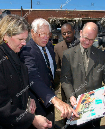 FELLER CAMPBELL VOLPE Cleveland Indians Hall of Fame pitcher Bob Feller, second from left, points to drawings of a proposed renovation of League Park in Cleveland with Mayor Jane Campbell, left, and architect Paul Volpe . The city is renovating the former home of the Indians and Negro League Cleveland Buckeyes