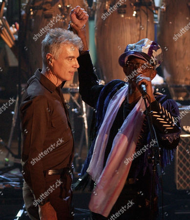 BYRNE WORRELL Bernie Worrell, right, holds the hand of David Byrne after the Talking Heads were inducted into the Rock and Roll Hall of Fame, at New York's Waldorf Astoria