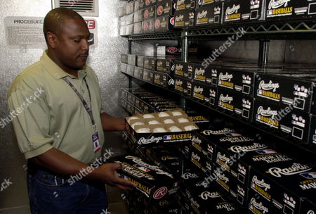 TONY COWELL Tony Cowell, an engineer at Coors Field, inspects a dozen baseballs stored in a walk-in humidor at Coors Field in Denver on . The Colorado Rockies began storing baseballs for home games in the humidor this season. It was Cowell's idea and it was approved by general manager Dan O'Dowd
