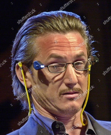 PENN Actor Sean Penn wears reading glasses with a light before he presented actor Kevin Spacey with an award at the San Francisco Film Society Awards in San Francisco, . Spacey received the 7th annual legendary Peter J. Owens Award