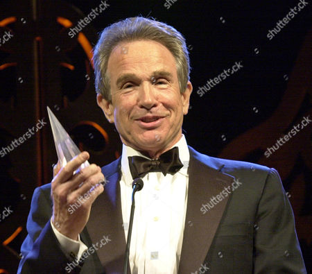 SPACEY BEATTY Actor Warren Beatty holds up actor Kevin Spacey's award that Spacey jokingly gave him during the San Francisco Film Society Awards in San Francisco, . Spacey received the 7th annual legendary Peter J. Owens Awards. Beatty was presented the 17th annual Akira Kurosawa Award for lifetime achievement in film directing