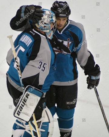 NABOKOV HARVEY San Jose Sharks right winger Todd Harvey celebrates with goalie Evgeni Nabokov (35) after San Jose beat the Colorado Avalanche 6-3 in the opening game of the NHL Western Conference semifinal series in Denver