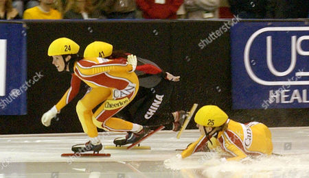 GOULET-NADON DROLET LIU Canada's Amelie Goulet-Nadon, right, falls as teammate Marie-Eve Drolet, left and China's Liu Xiaoying, middle, skate on in the women's 3,000 meters at the World Short Track Speedskating Team Championships, in West Allis, Wis