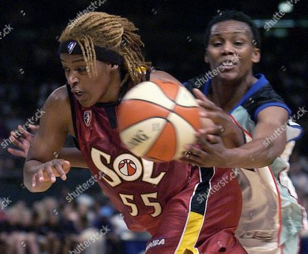 ROBINSON SAM New York Liberty's Crystal Robinson reaches for the ball as Miami Sol's Sheri Sam heads for the basket during the second half at Madison Square Garden in New York