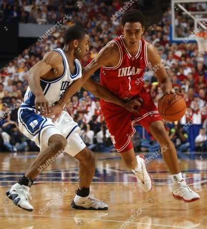 JEFFRIES, JONES Indiana's Jared Jeffries, right, moves the ball upcourt against Duke's Dahntay Jones during the second half of their NCAA South Regional semifinal game at Rupp Arena in Lexington, Ky. . Jeffries scored 24 points and had 15 rebounds as Indiana beat Duke 74-73