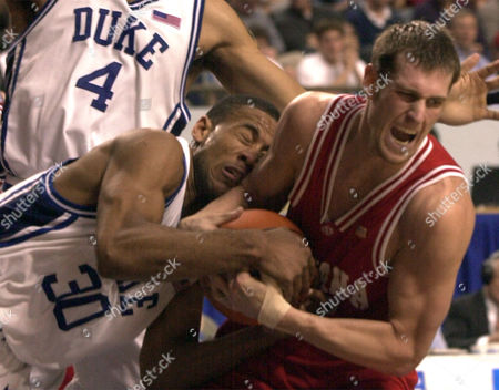 JONES, ODLE Duke's Dahntay Jones, left, and Indiana's Jarrad Odle wrestle for the ball during the second half of their NCAA South Regional semifinal game at Rupp Arena in Lexington, Ky