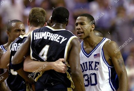 JONES CARROLL HUMPHREY Duke's Dahntay Jones (30) confronts Notre Dame's Ryan Humphrey (4) and Matt Carroll after an agressive play in the first half of their second-round NCAA South regional game, at the Bi-Lo Center in Greenville, S.C. Duke won 84-77