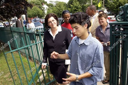 SWIFT SUSTACHE Massachusetts acting Gov. Jane Swift, left, speaks with student Derrick Sustache at the James Curley Elementary School in Boston, . The School to Career program at the Curley School is a four week summer program serving 54 8th graders from around the city of Boston. Critics of Swift's vetoes are urging lawmakers to override the spending cuts