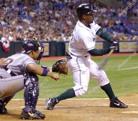 VAUGHN RIVERA Tampa Bay Devil Rays' Greg Vaughn singles in the game-winning run during the eighth inning of their 9-5 win over the Detroit Tigers Tuesday night at Tropicana Field in St. Petersburg, Fla. Catching for Detroit is Michael Rivera