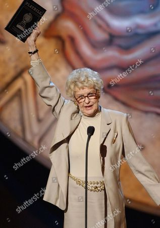"""STRITCH Elaine Stritch announces the winner of the best book of a musical, Greg Kotis, for """"Urinetown, the Musical,"""" during the 56th annual Tony Awards, at New York's Radio City Music Hall"""