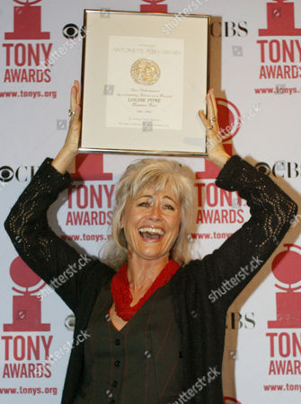 "PITRE Louise Pitre holds up her Tony Award nomination certificate for best performance by a lead actress in a musical for her performance in ""Mamma Mia"" during a luncheon in New York"
