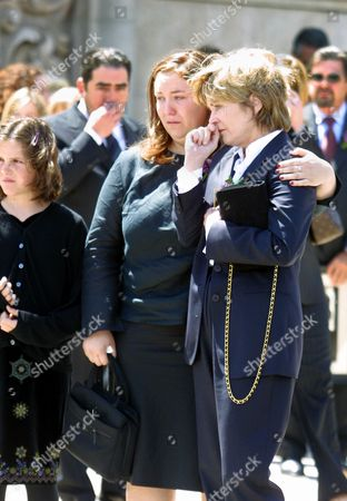 """MENZIES URICH Heather Menzies, right, widow of actor Robert Urich, is comforted by their daughter, Emily, following a public memorial for Urich in the North Hollywood area of Los Angeles, . Urich, an Emmy-winning actor best known for his starring roles in sleuth series such as """"Vega$"""" and """"Spenser: For Hire,"""" died Tuesday at a California hospital of cancer. He was 55"""