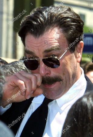 """Stock Image of SELLECK Actor Tom Selleck wipes eye following a public memorial for Robert Urich in the North Hollywood area of Los Angeles. Urich, who died of cancer April 16, starred in such television series as """"Vega$,"""" """"SWAT"""" and """"Spencer for Hire"""