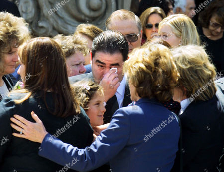 """LAGASSE Television host and chef Emeril Lagasse clears his eyes following a public memorial for Robert Urich, in the North Hollywood area of Los Angeles. Urich, who died of cancer April 16, starred in such television series as """"Vega$,"""" """"SWAT"""" and """"Spencer for Hire"""