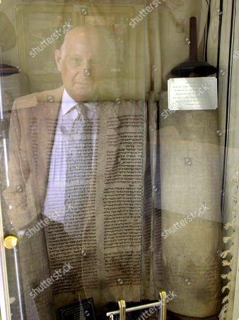 ROSEN ADVANCE FOR FRIDAY AMS, MARCH 22--Sam Rosen stands, reflected in the display case for the Torah scroll that he helped bring back from Czechoslovakia in 1994 to the Jewish Community Center in Scranton, Pa. Rosen, who emigrated from Czechoslovakia after his parents and 11 brothers and sisters died in the war, helped found the Holocaust Museum and Resource Center of Scranton, which consists of a couple of showcases in the lobby of the Jewish center