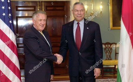 Stock Image of POWELL KOVACS Secretary of State Colin Powell, right, greets Hungary's Foreign Minister Laszlo Kovas prior to their meeting at the State Department in Washington