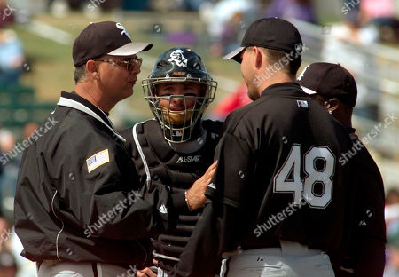 DURHAM Chicago White Sox pitching coach Nardi Contreras, left, talks with starter Todd Ritchie (48), as catcher Mark Johnson and second baseman Ray Durham, obscured at right, look on in the second inning against the Arizona Diamondbacks at Tucson Electric Park in Tucson Ariz. Ritchie went five innings, but gave up seven earned runs from 11 hits and the Diamondbacks beat the White Sox 16-13 in exhibition play