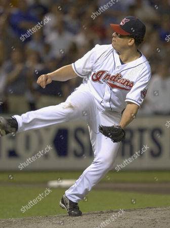 Stock Image of COLON Cleveland Indians pitcher Bartolo Colon lets loose with a fast ball to Chicago White Sox batter Mark Johnson in the ninth inning, in Cleveland. Colon pitched his fourth complete game of the season in the Indians 7-0 victory