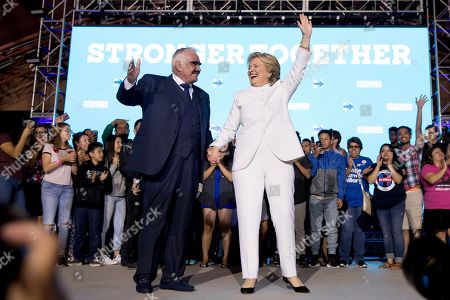 Stock Photo of Hillary Clinton, Vicente Fernandez Democratic presidential candidate Hillary Clinton, right, and singer Vicente Fernandez, left, stand on stage together at debate watch party at the Craig Ranch Regional Amphitheater in North Las Vegas, following the third presidential debate
