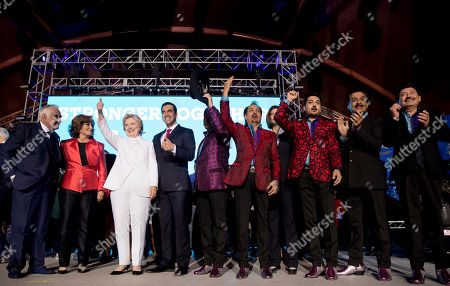 Stock Picture of Hillary Clinton, Vicente Fernandez, Angelica Maria, Los Tigres del Norte Democratic presidential candidate Hillary Clinton, third from left, singer Vicente Fernandez, left, Mexico singer and actress Angelica Maria, second from left, and members of the band Los Tigres del Norte, at right, stand on stage together at a debate watch party at the Craig Ranch Regional Amphitheater in North Las Vegas, following the third presidential debate