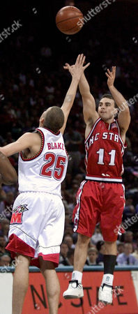 MILLER BLAKE North Carolina State's Archie Miller (11) shoots over Maryland's Steve Blake (25) during first half action at the ACC Men's Basketball Tournament, in Charlotte, N.C
