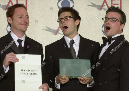 "GRIMES GOMEZ HUGHES Actors, from left, Scott Grimes, Rick Gomez and Frank John Hughes, from the cast of the mini-series ""Band of Brothers,"" hold up the AFI Award for mini-series of the year at the 2001 AFI Awards in Beverly HIlls, Calif., . The awards, created by the American Film Institute, honor achievements in film and television. The three actors accepted the award on behalf of the cast"