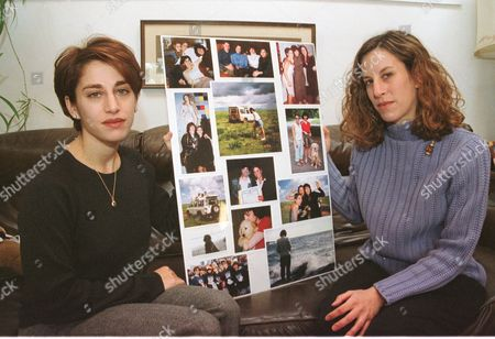LEMACK Carie Lemack, left, of Cambridge, Mass., and her sister Danielle Lemack of Chicago, are seen at their mother's home in Framingham, Mass., holding a board of photos showing them with their mom Judy Larocque, who was aboard American Airlines Flight 11 on September 11th. The Lemack sisters are part of an online community for family members who lost loved ones in the terrorist attacks