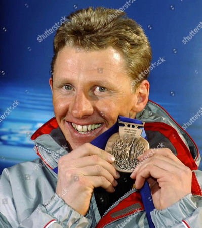 """Wolfgang Perner FILE ** Austrian biathlete Wolfgang Perner with a bronze medal at the Olympic Winter Games 2002 in Salt Lake City USA Feb 13, 2002. The head of the Austrian Ski Federation vowed that his organization would """"get to the bottom"""" of a doping scandal at the 2006 Winter Games in Turin that has led to the banning for life of six Austrian athletes from the Olympics. The IOC identified the banned Austrians as retired biathletes Wolfgang Perner and Wolfgang Rottmann, and cross-country skiers Martin Tauber, Juergen Pinter, Johannes Eder and Roland Diethart"""