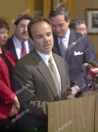 MAYORS Bridgeport Mayor Joseph Ganim speaks at a news conference at the state Capitol in Hartford, Conn., . Mayors of Connecticut's larger cities met to express their concerns over the governor's proposed budget as it will affect their citizens. At right behind Ganim is New Haven Mayor John DeStefano