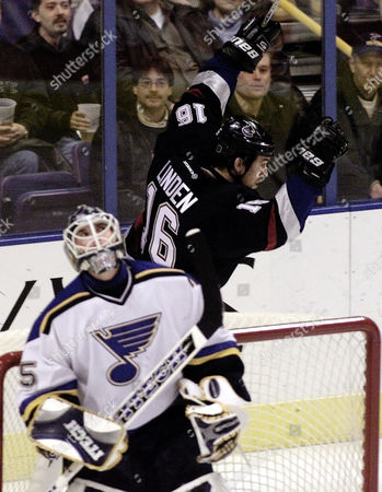 LINDEN JOHNSON Vancouver Canucks' Trevor Linden celebrates his score behind St. Louis Blues goalie Brent Johnson in the first period, at the Savvis Center in St. Louis