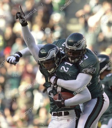 TAYLOR VINCENT Philadelphia Eagles' Bobby Taylor, left, reacts as he and teammate Troy Vincent, right, celebrate an interception during the first quarter against the San Diego Chargers, in Philadelphia. The Eagles won 24-14
