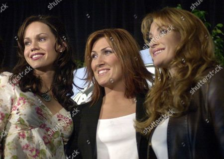 """THOMSON MESSINA SEYMOUR Vocalist Cyndi Thomson, left, double-platinum country star Jo Dee Messina, center, and actress Jane Seymour, right, pose together after announcing the nominations for the 37th annual Academy of Country Music awards, in Universal City, Calif. Thomson is nominated for Top New Female Vocalist and Messina was nominated for Vocal Event of the Year for her song, """"Bring on the Rain."""" The winners will be announced at the awards show on May 22, 2002. Toby Keith and duo Brooks & Dunn hada leading six nominations each Thursday for Academy of Country Music Awards with both vying for album and entertainer of the year"""