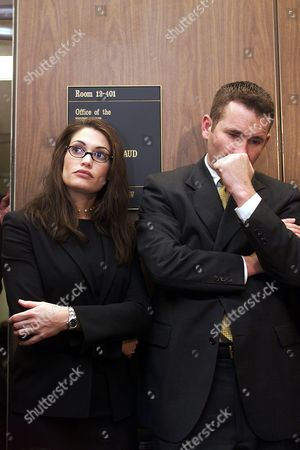 """GUILFOYLE NEWSOM HAMMER San Francisco prosecutor Kimberly Guilfoyle-Newsom, left, and Assistant District Attorney Jim Hammer listen to Sharon Smith, describe Diane Whipple's prior encounters with two dogs that ultimately killed her Jan. 26, 2001, during a news conference at the Los Angeles Superior Court in Los Angeles. A defense lawyer in the San Francisco dog mauling case stunned the court Thursday by suggesting that Whipple might still be alive if her """"life partner,"""" Sharon Smith had complained about a previous dog attack"""