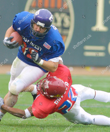BREWER SHOBEL West tight end Matt Shobel from Texas Christian, left, is brought down by East's Jack Brewer of Minnesota during the Shrine all-star game in San Francisco, . The West won 21-13