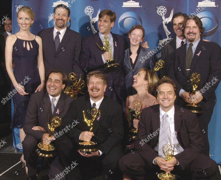 """WEST WING Members of the cast and crew of """"The West Wing"""" pose for photographers after winning the Emmy for outstanding drama series at the 53rd annual Primetime Emmy Awards at the Shubert Theatre in Los Angeles, . From back left are: Janel Maloney, Thomas Schlamme, Aaron Sorkin, Kristin Harms, Kevin Falls and Llewellyn Wells. From bottom left are: Mike Hissrich, John Wells, Allison Janney and Bradley Whitford"""