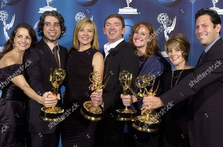 """STAR From left, actress Kristin Davis, producer John Melfi, actress Kim Cattrall, producer Michael Patrick King, producer Cindy Chupack, producer Jenny Bicks and producer Darren Star hold up their Emmys for outstanding comedy series for """"Sex and the City"""" at the 53rd annual Primetime Emmy Awards at the Shubert Theatre in Los Angeles"""